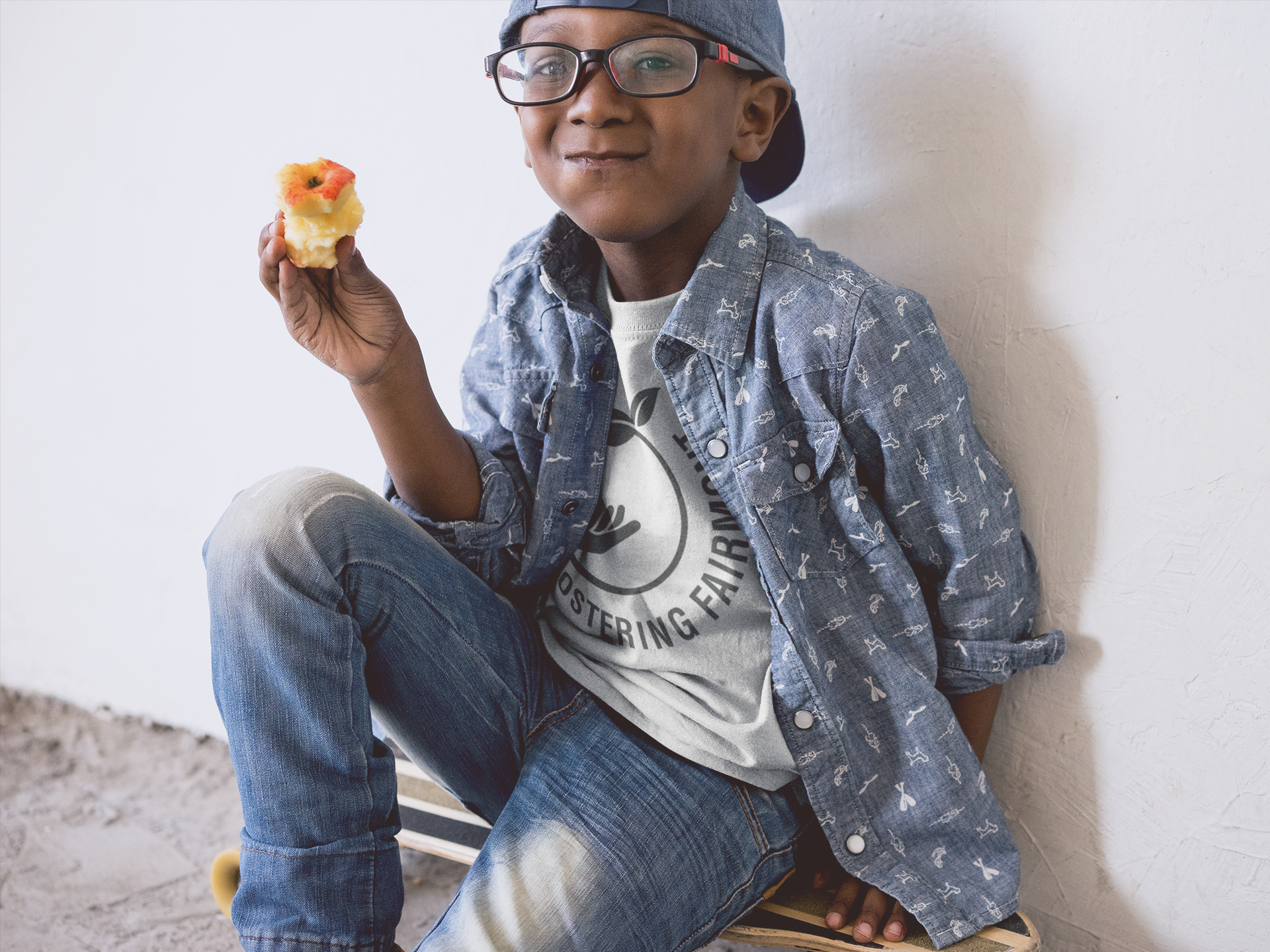 kid-s-t-shirt-mockup-of-a-young-boy-eating-an-apple-a12075.png