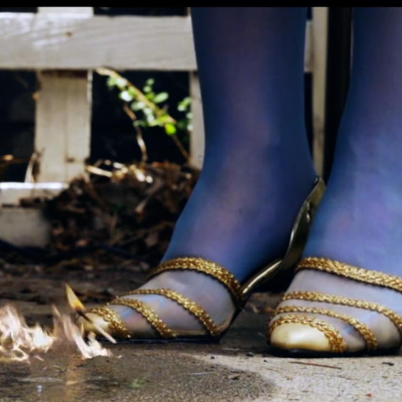 Rita Mat_Feet and flame .png