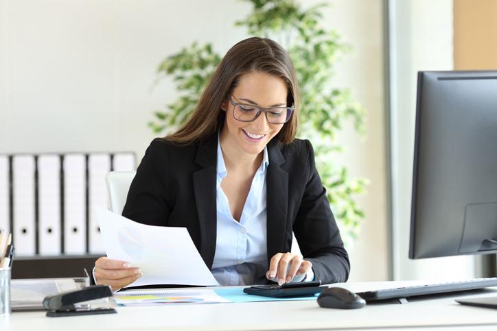 woman looking a pay calculator.jpg