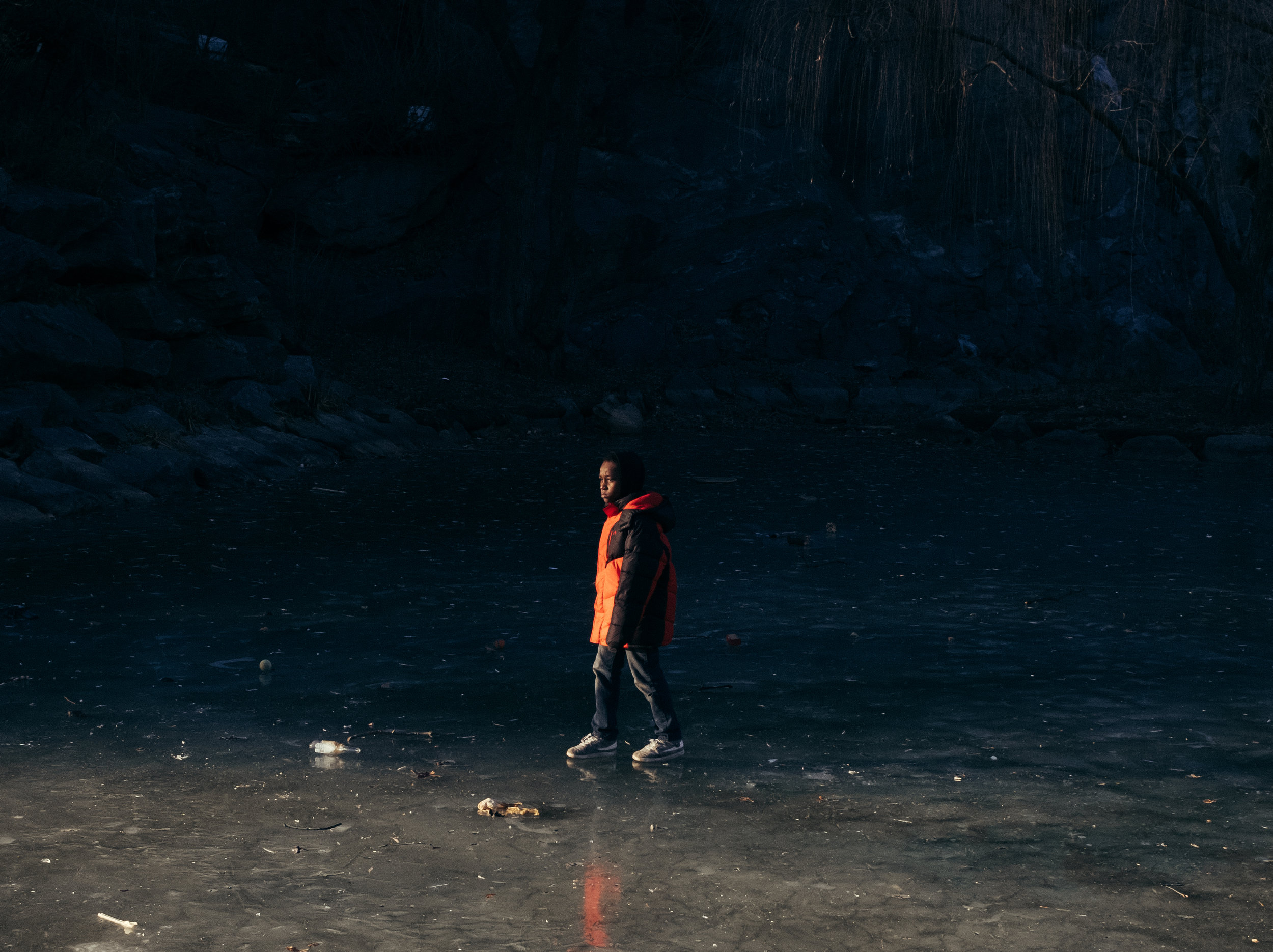 Kid on frozen lake, Harlem, New York