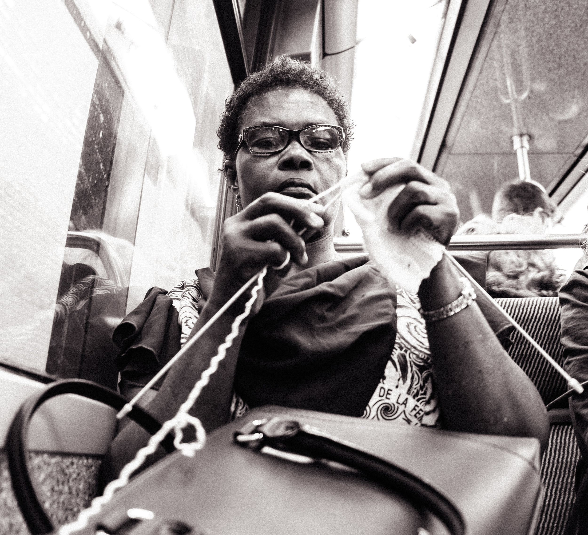 Knitting woman in the subway, Paris