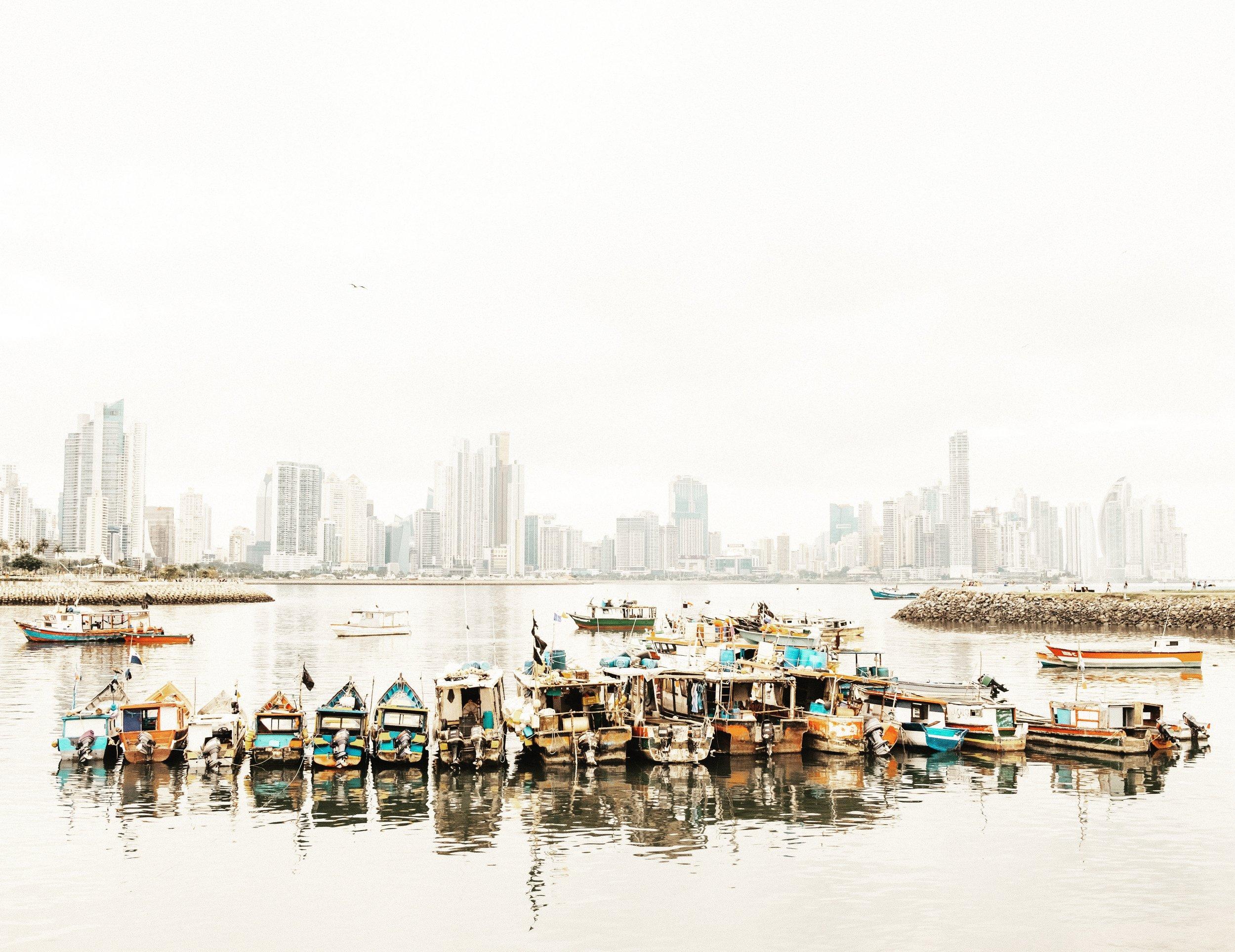 Panama City, between luxury building skyline and poor fishermen.