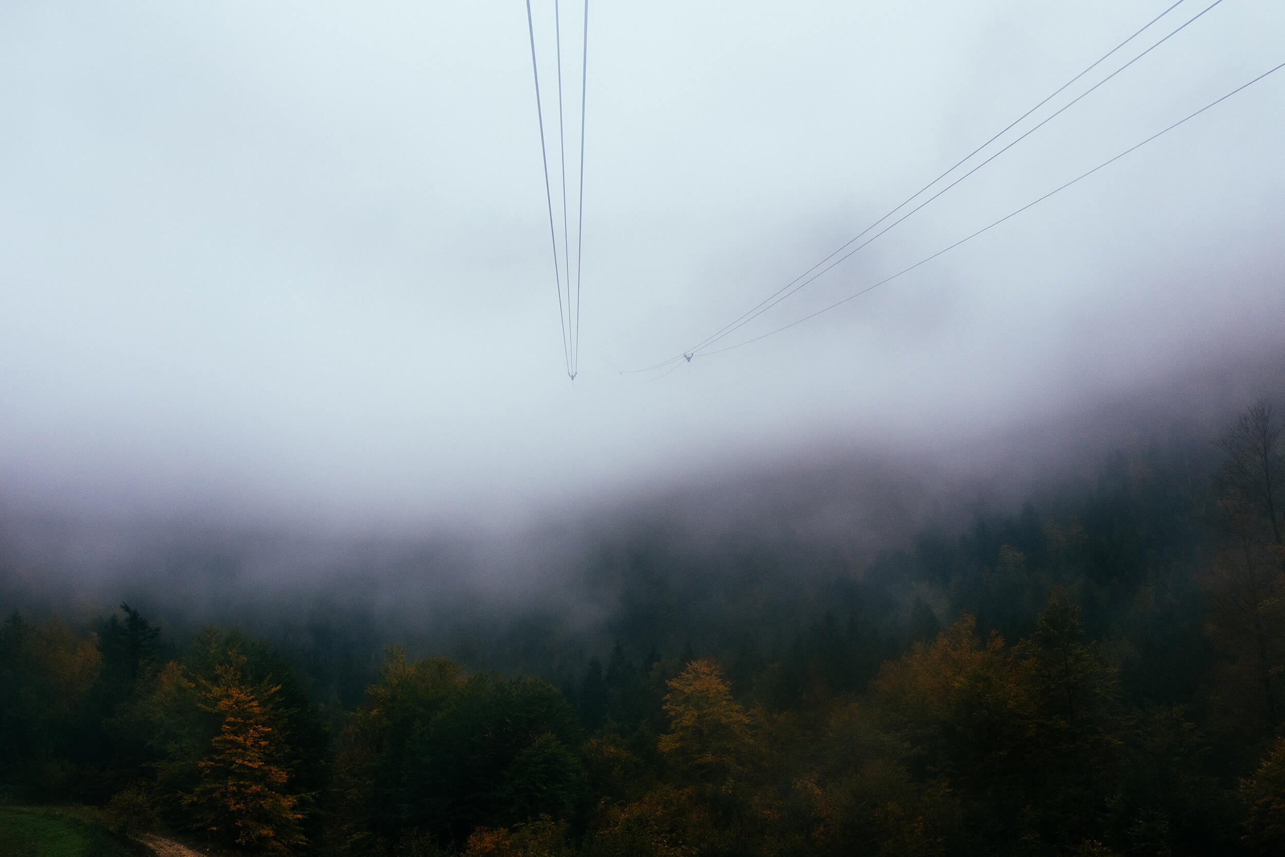 """""""The cable car is sometimes completely immersed in a dense fog"""""""
