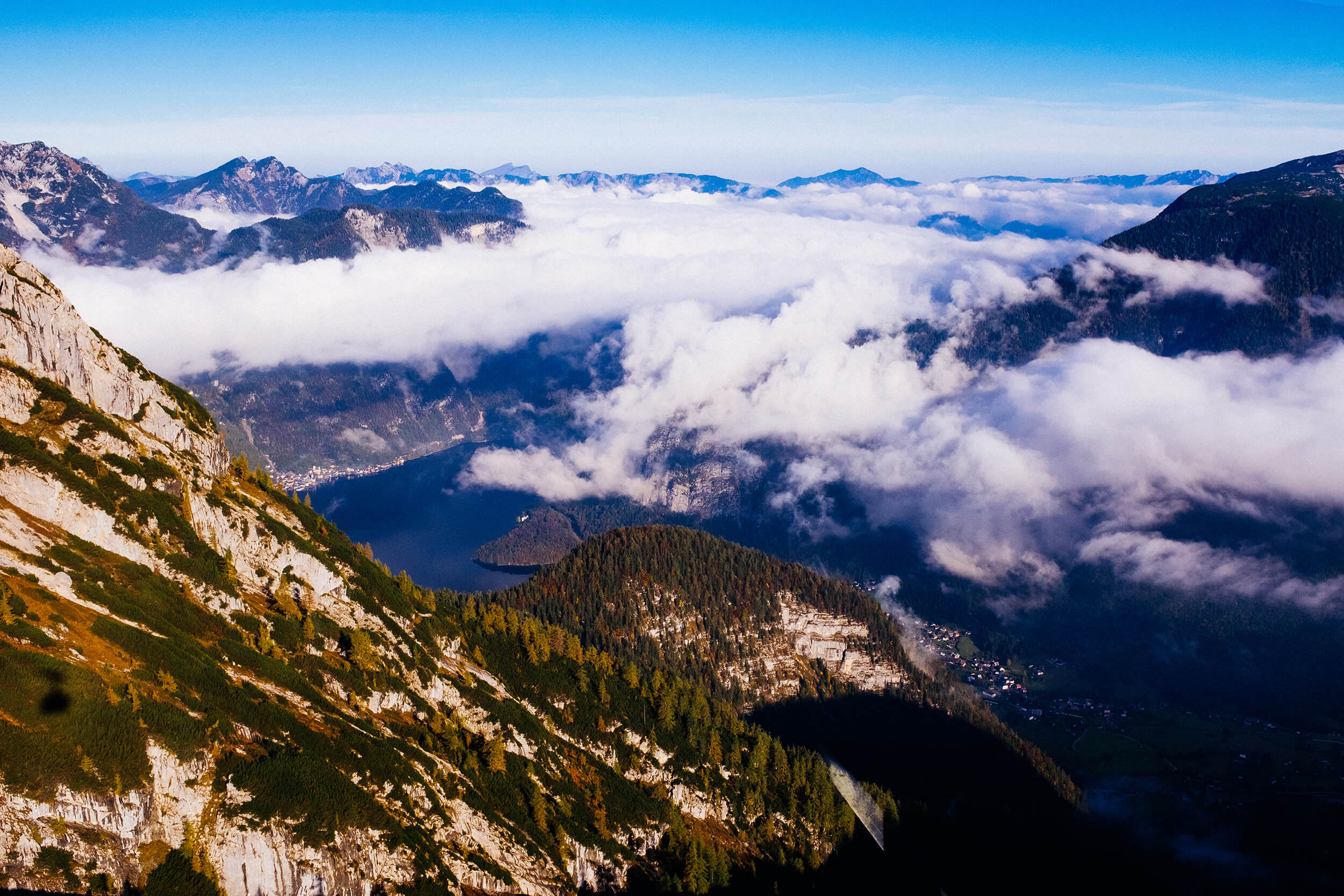 Clouds are mostly gone and the view offered by the cable car descent is breathtaking