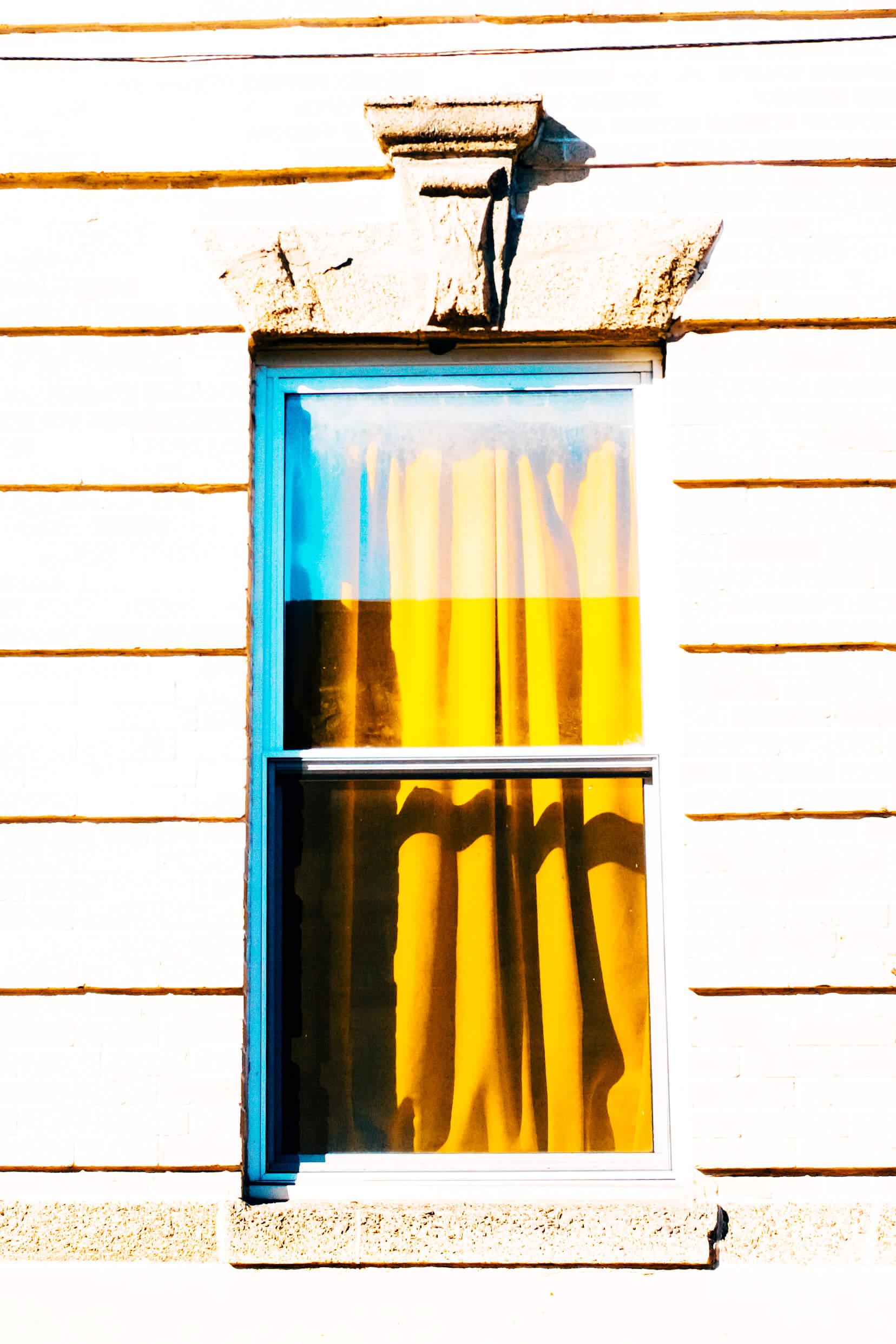 strangers-windows-yellow-curtain.jpg