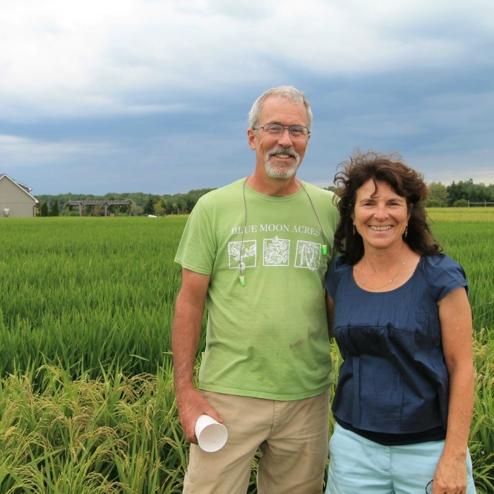 Blue-Moon-Acres-Owners-Jim-and-Kathy-Lyons-in-the-rice-fields-on-our-Pennington-NJ-farm-SQUARE-700x700.jpg
