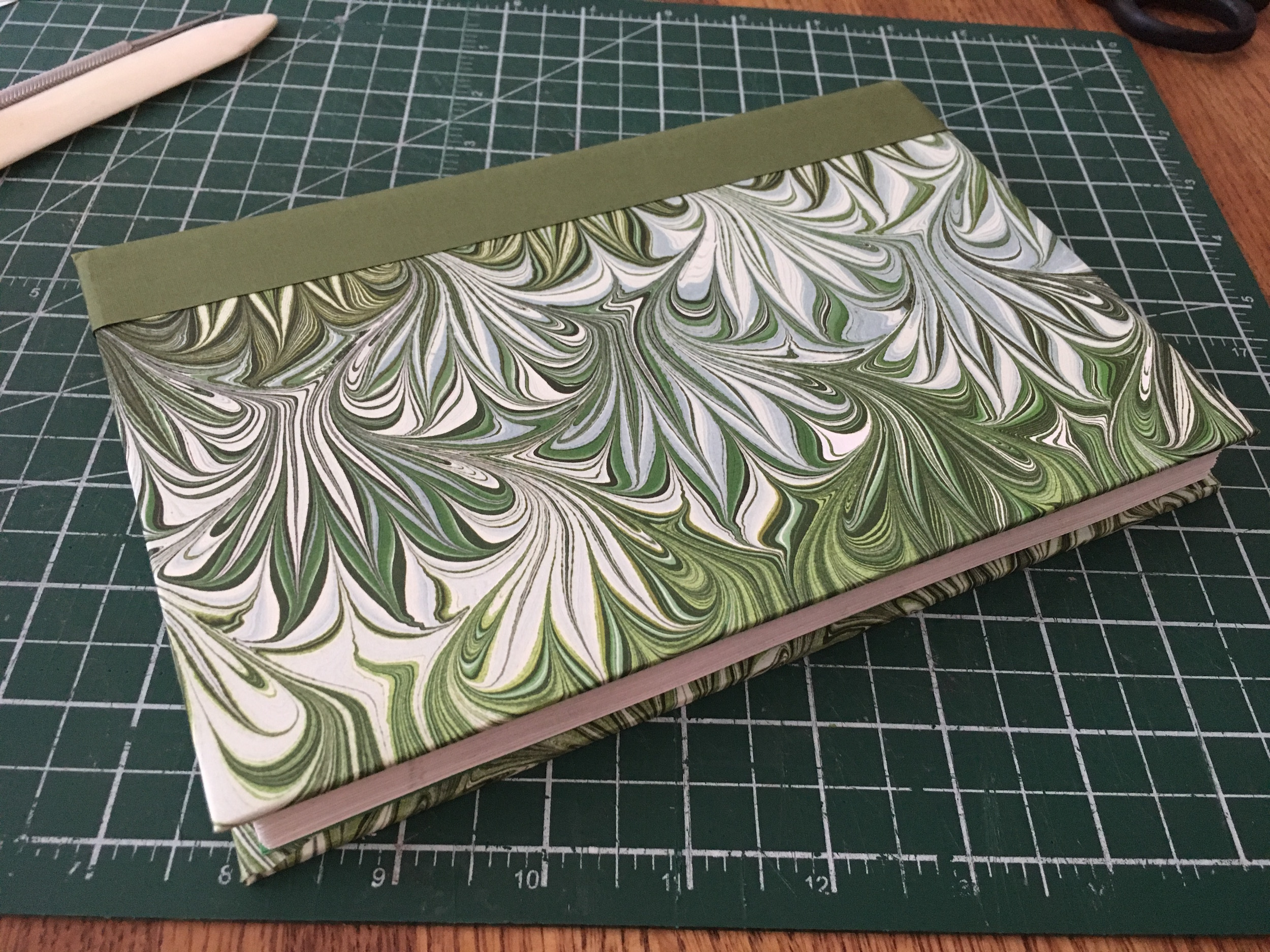 Step 10: - The finished book, just before it goes into my book press for the night. I've added the endpapers already but you can't really see them here.