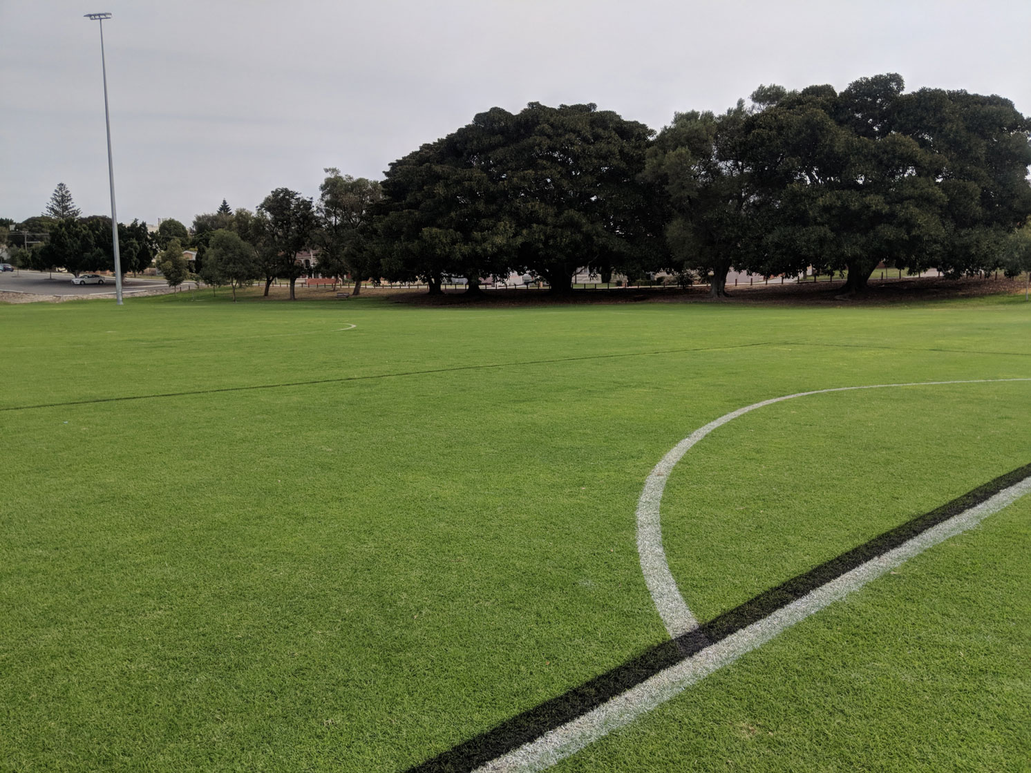 Soccer field with overlapping lines black and white paint line marking