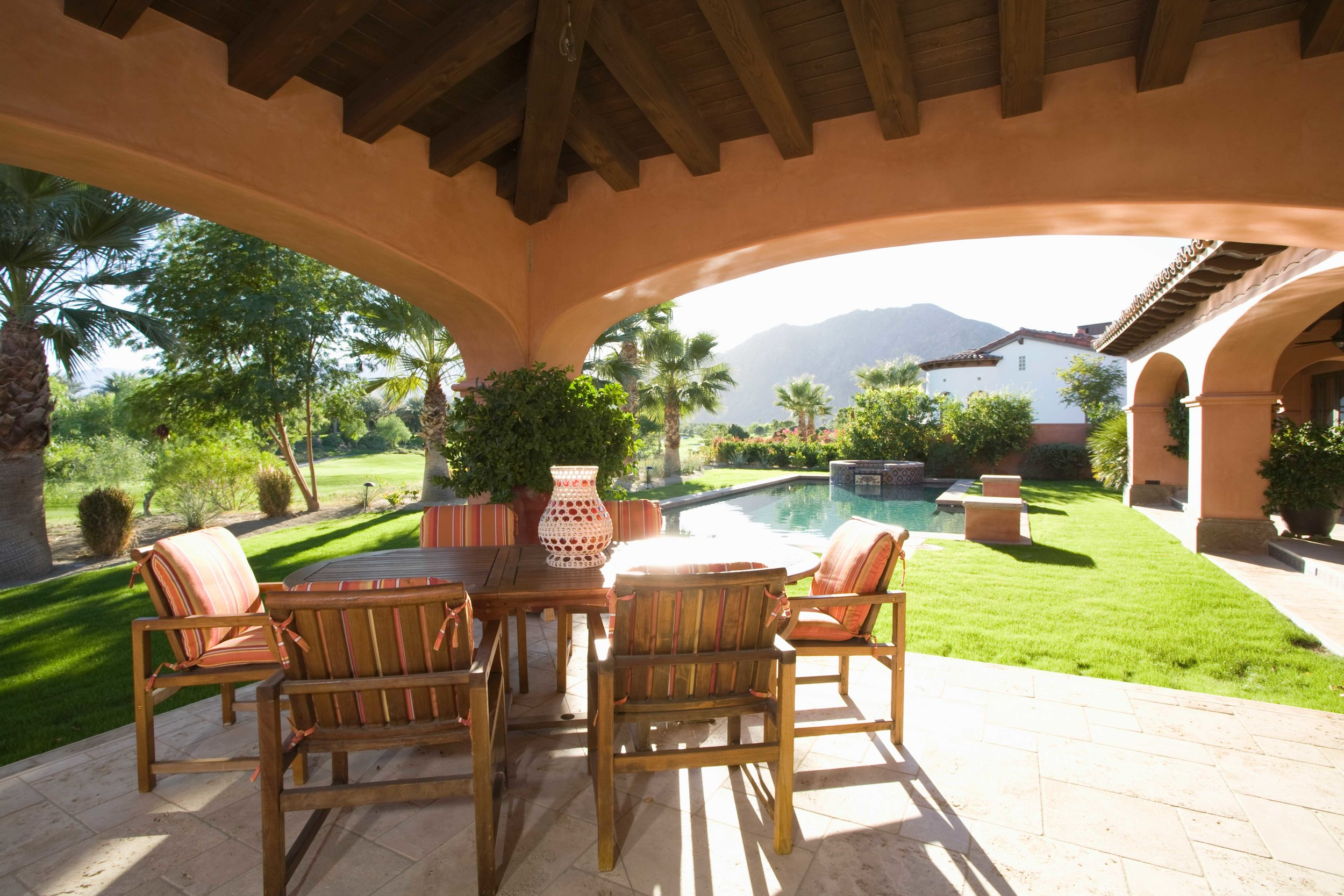 graphicstock-sitting-area-with-sunlit-lawn-against-mountain_BZ-xIpU2Xe-.jpg
