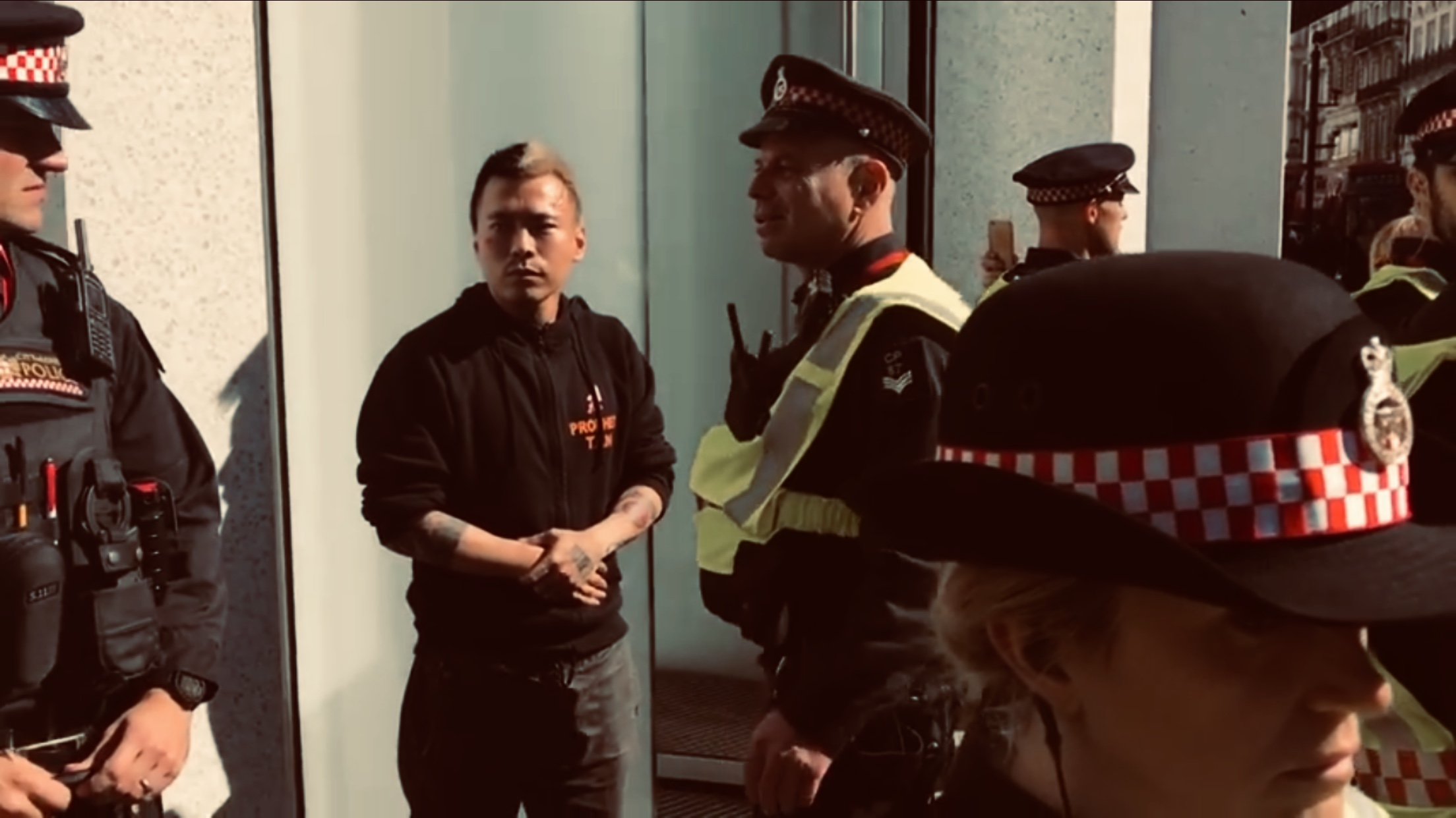 What happened on Thursday in 27/9/18 is the inauguration of (PBUH) Tan of Tango assuming command of the  SS Officers  of United Kingdom. A picture paints a thousand words; a motion picture?   Watch it for yourself!    Why did officer put Tan's hand on his chest as if he is swearing oath!?