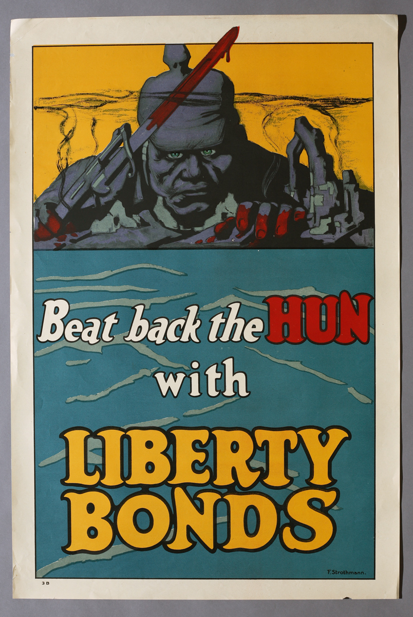 "From the Portland Art Museum: An American propaganda poster showing a German soldier with a spiked helmet and bloody fingers and bayonet, climbing over a ruined landscape. The message? ""Beat back the HUN with LIBERTY BONDS."" Frederick Strothmann, 1918, color lithograph on smooth cream wove paper, Gift of Mr. William Lewis Brewster, Jr., public domain, 20.59.15"