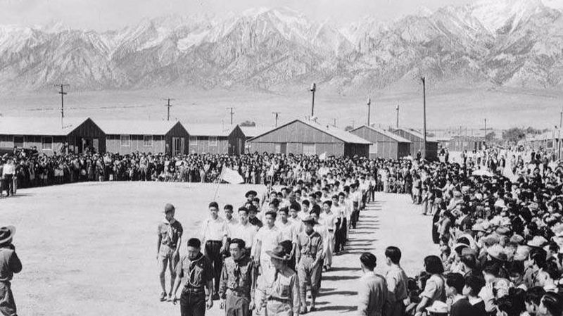 A public ceremony at the bleak Manzanar internment camp in Owens Valley, California. From the LA Times.