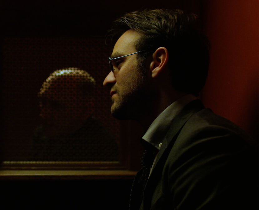 In this scene from Marvel's  Daredevil,  Matt Murdock (Charlie Cox) sits in a church confessional, preparing to ask Father Lantom (Peter McRobbie) whether it's okay for him to make a role-playing game about priests.
