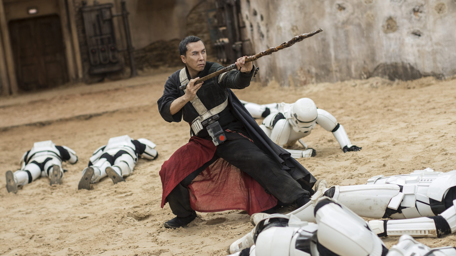 The mystical staff fighter Chirrut Îmwe, surrounded by downed stormtroopers in  Rogue One: A Star Wars Story.  I am so glad this movie had a second Chinese guy who acted completely different standing right next to him all the time, or I wouldn't have been able to get over the stereotype and enjoy Donnie Yen's performance.