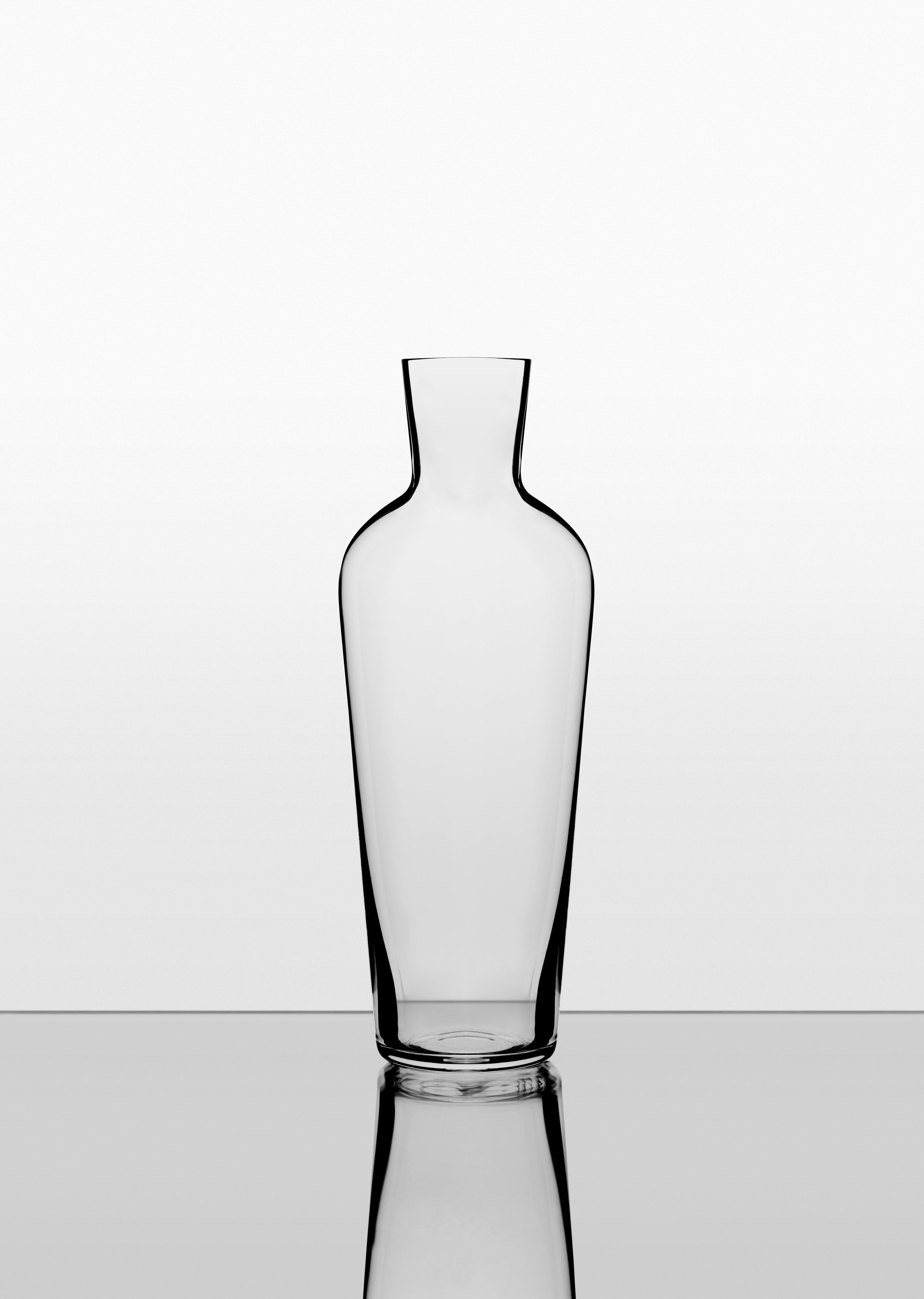 The Water Carafe - This is the bottle-shaped Old Wine Decanter without the stopper, an understated and versatile water carafe which follows the form of the Wine Glass and the Water Glass to create a beautiful and refined suite.It also fits in the fridge door, keeping your water, or white wine, perfectly chilled.