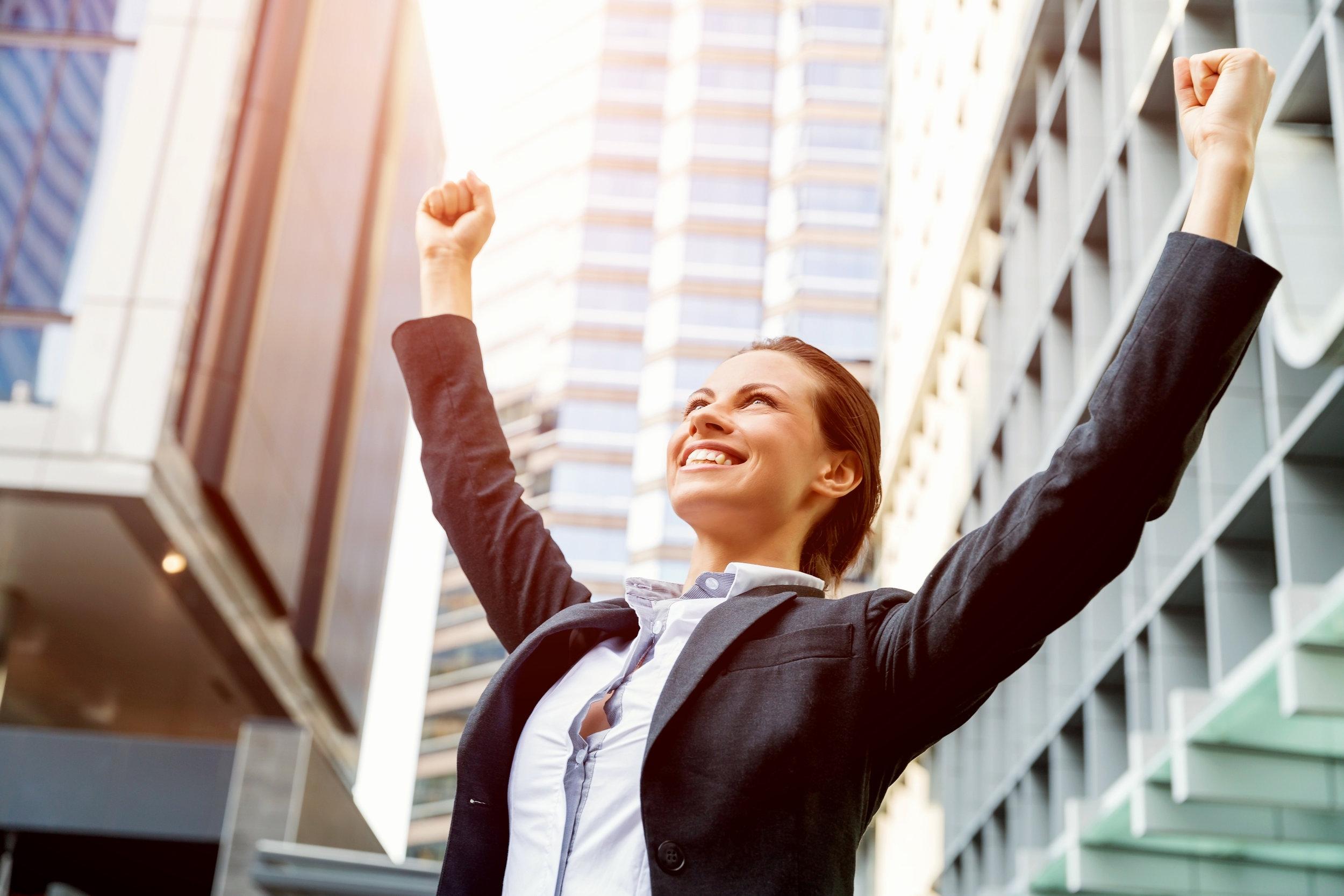 biz lady celebrates_shutterstock_384641254.jpg