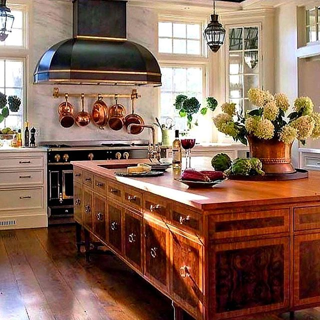 My mother always said that a touch of black grounds a room. Between the handsome wood island with substantial brass pulls, and the crisp white walls, trim and marble, the black stove demands your attention like a grand dame, with the gleaming copper pots appearing like the perfect earrings! #regrann: @splendorinthesouth •• •• •• #classicinteriordesign #classicinteriors #classicdesign #designinspiration #beautifulinteriors #goodmorning #kitchendesign #kitcheninspiration #kitchen #kitchens #kitchenisland #timelessstyle #traditional #hollyholden
