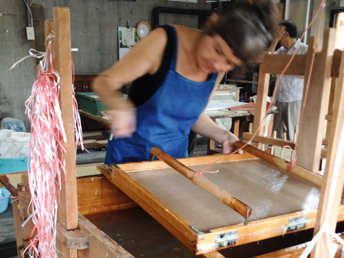 Claire making washi paper with the traditional Japanese Sugeta using the nagashizuki method
