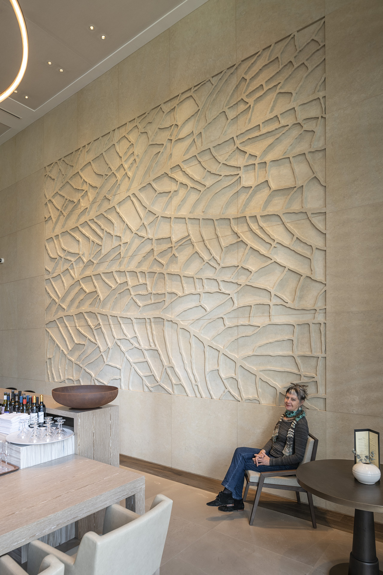'Ningaloo III' Claire Beausein seated in the Westin Hotel bar area next to her work