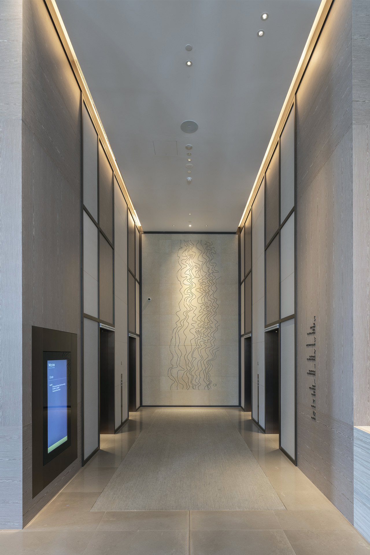 'Driftwood' 2018  Relief sculpture in sandstone, 500 x 200cm installed in the main lift lobby