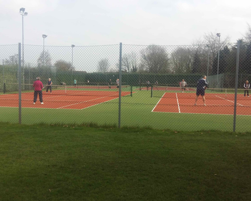 People playing tennis at an event
