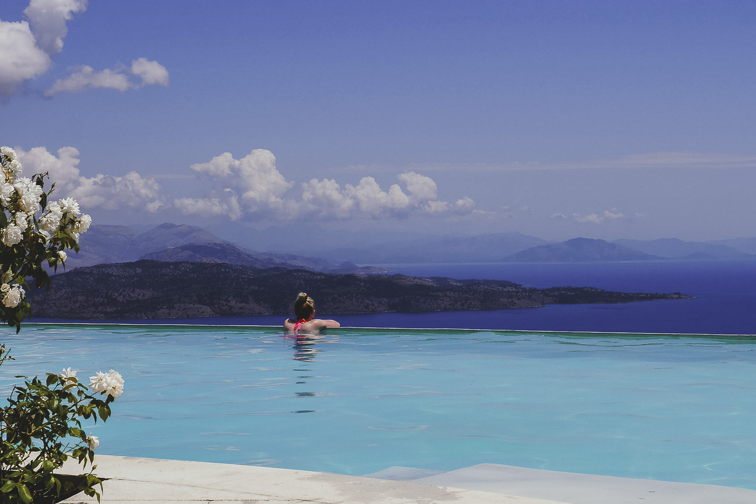 Looking out over an infinity pool - how to take a break from your business