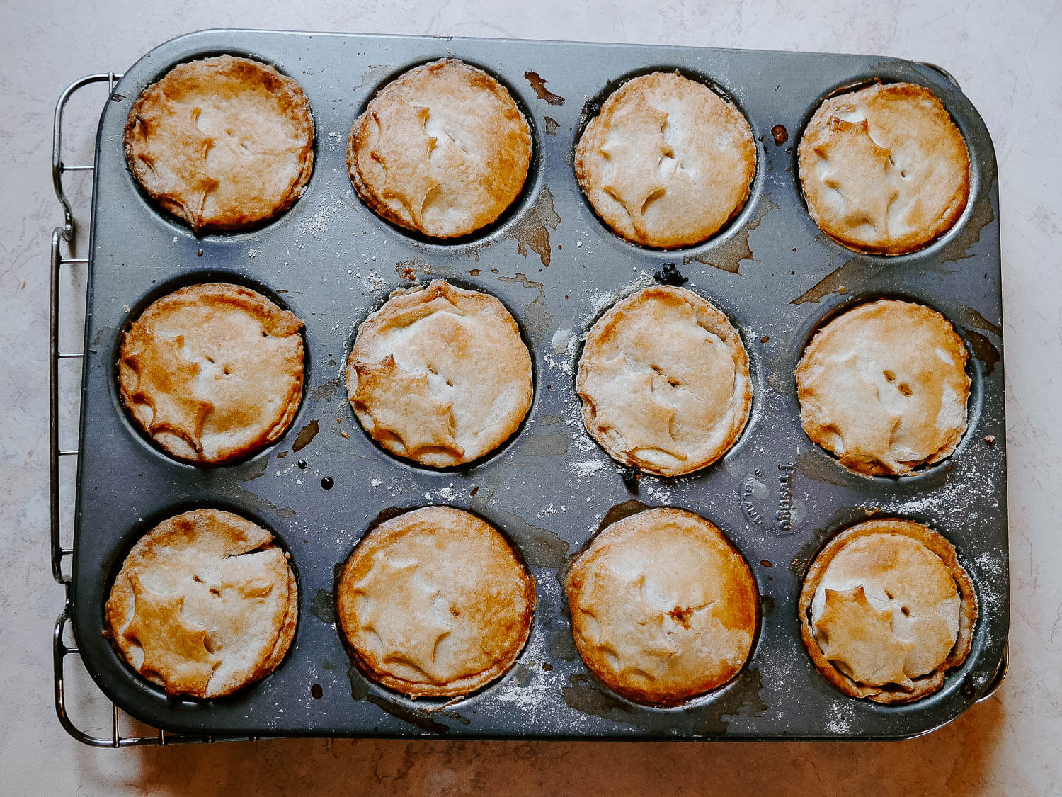 Homemade mince pies in a baking tray fresh form the oven