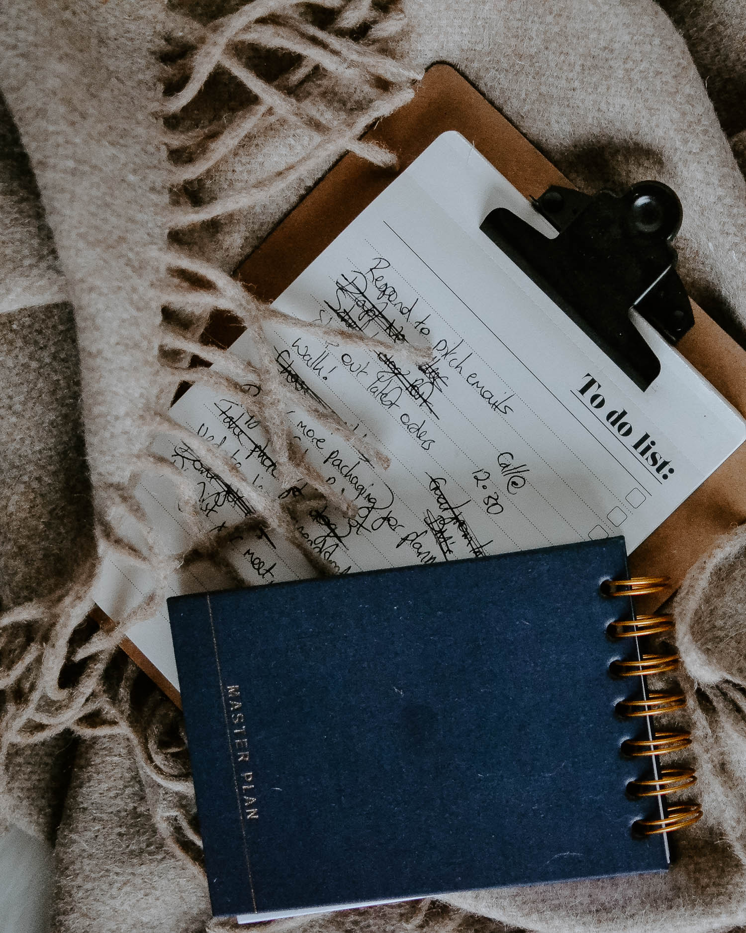 Notebooks piled up on cosy blanket