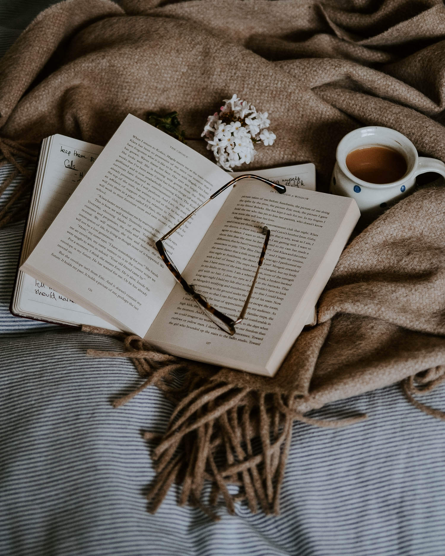 Reading in bed with a blanket and a cup of tea | Josephine Brooks