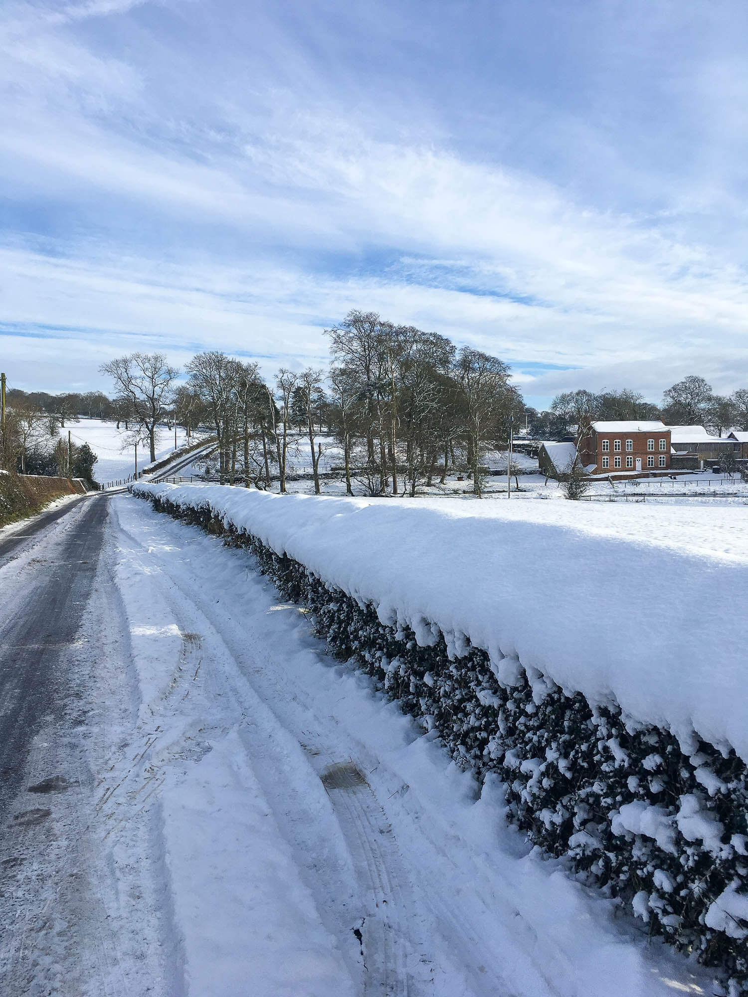 Country lane in snow, Shropshire, UK