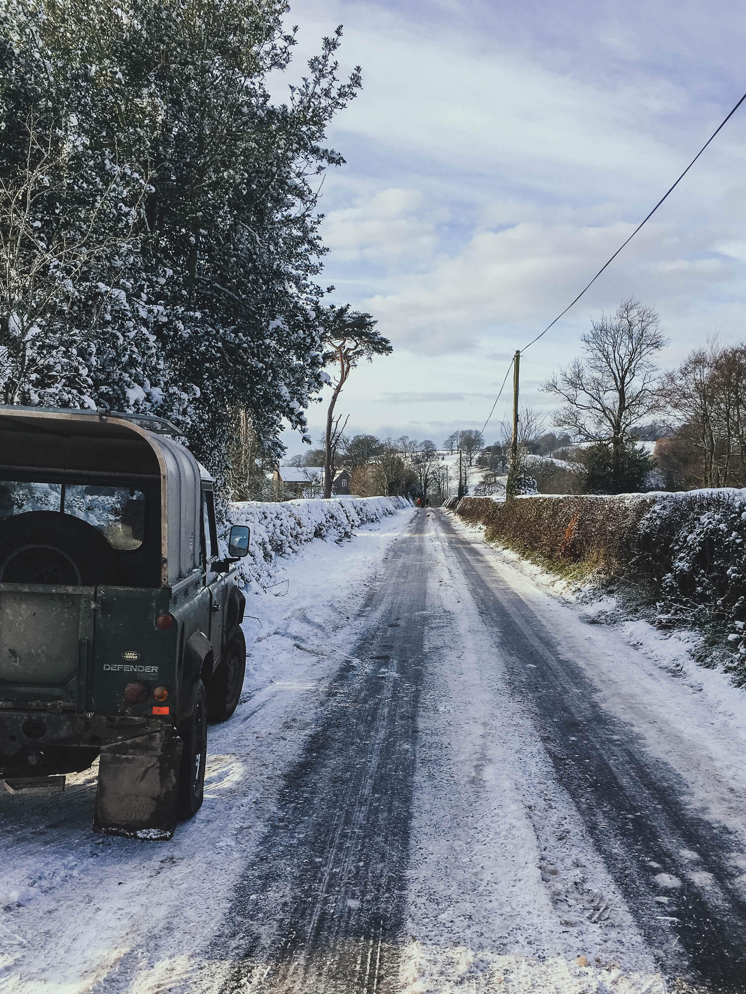 Green Land Rover Defender in the Snow, Shropshire, UK