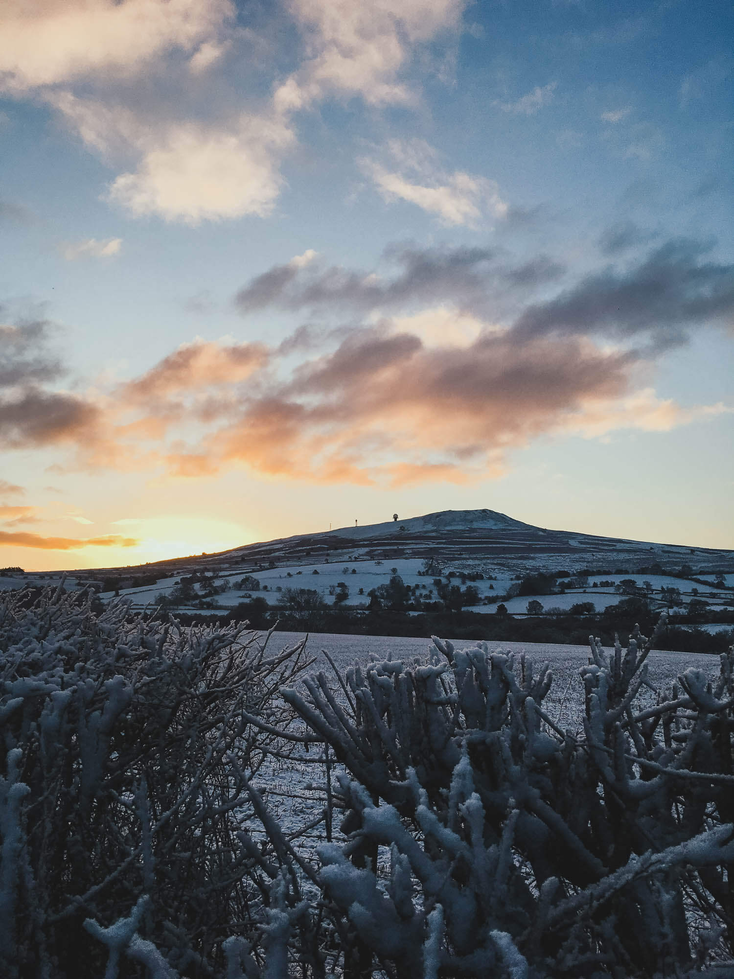 Sunset on Clee Hill in Shropshire over a landscape covered in snow - Clee hill