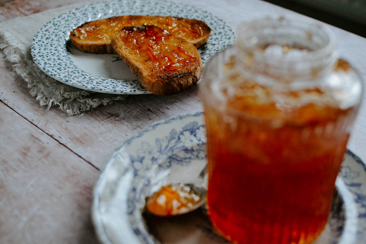 Farmhouse bread with marmalade on a rustic wooden table