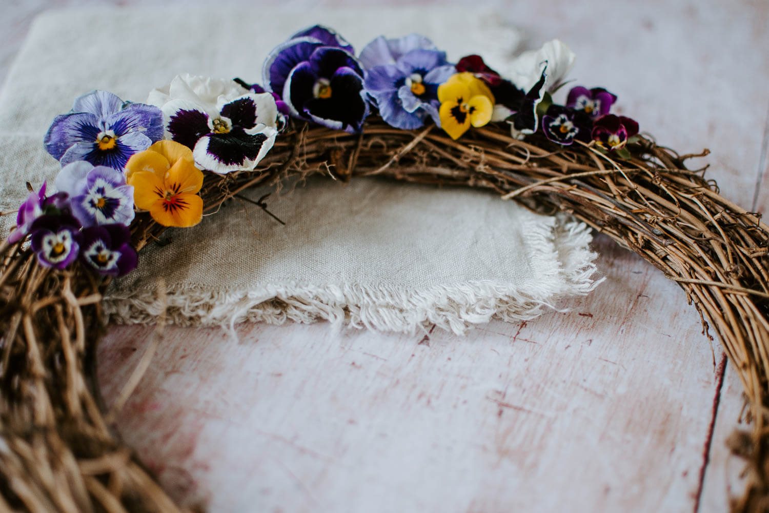 Pansies on a wooden wreath