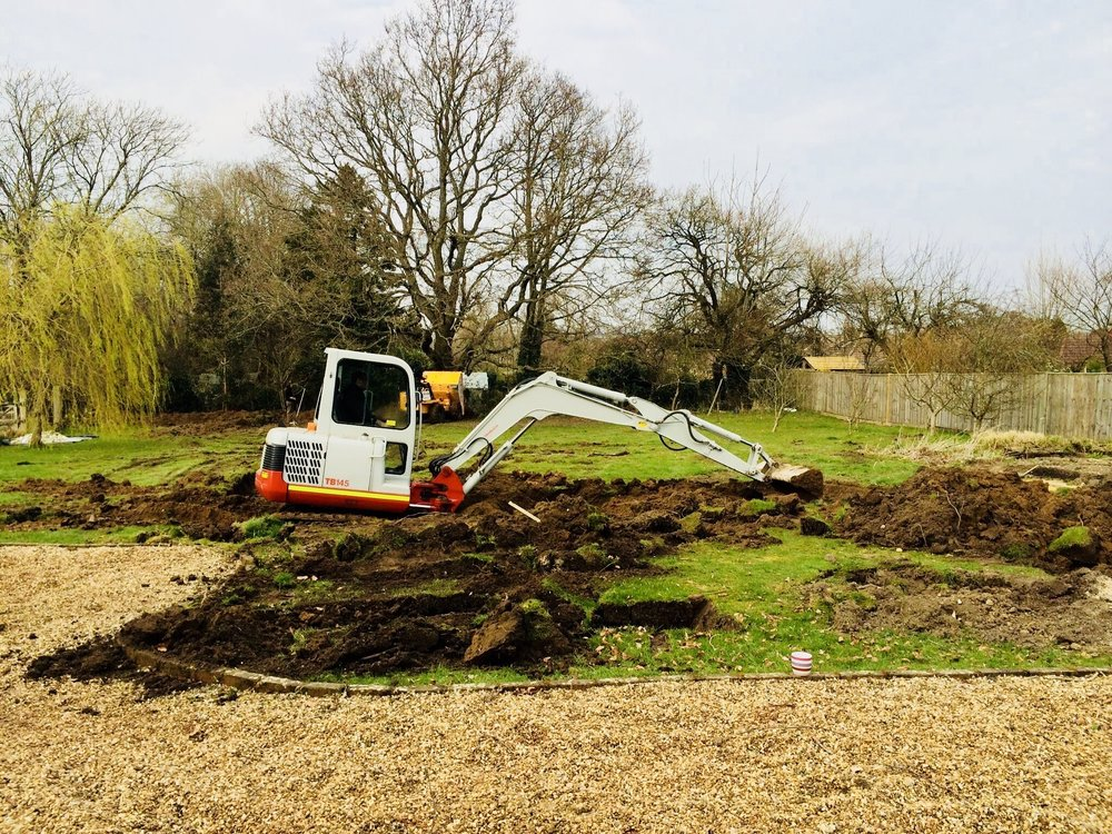 Digger digging out foundations for an eco home in West Sussex