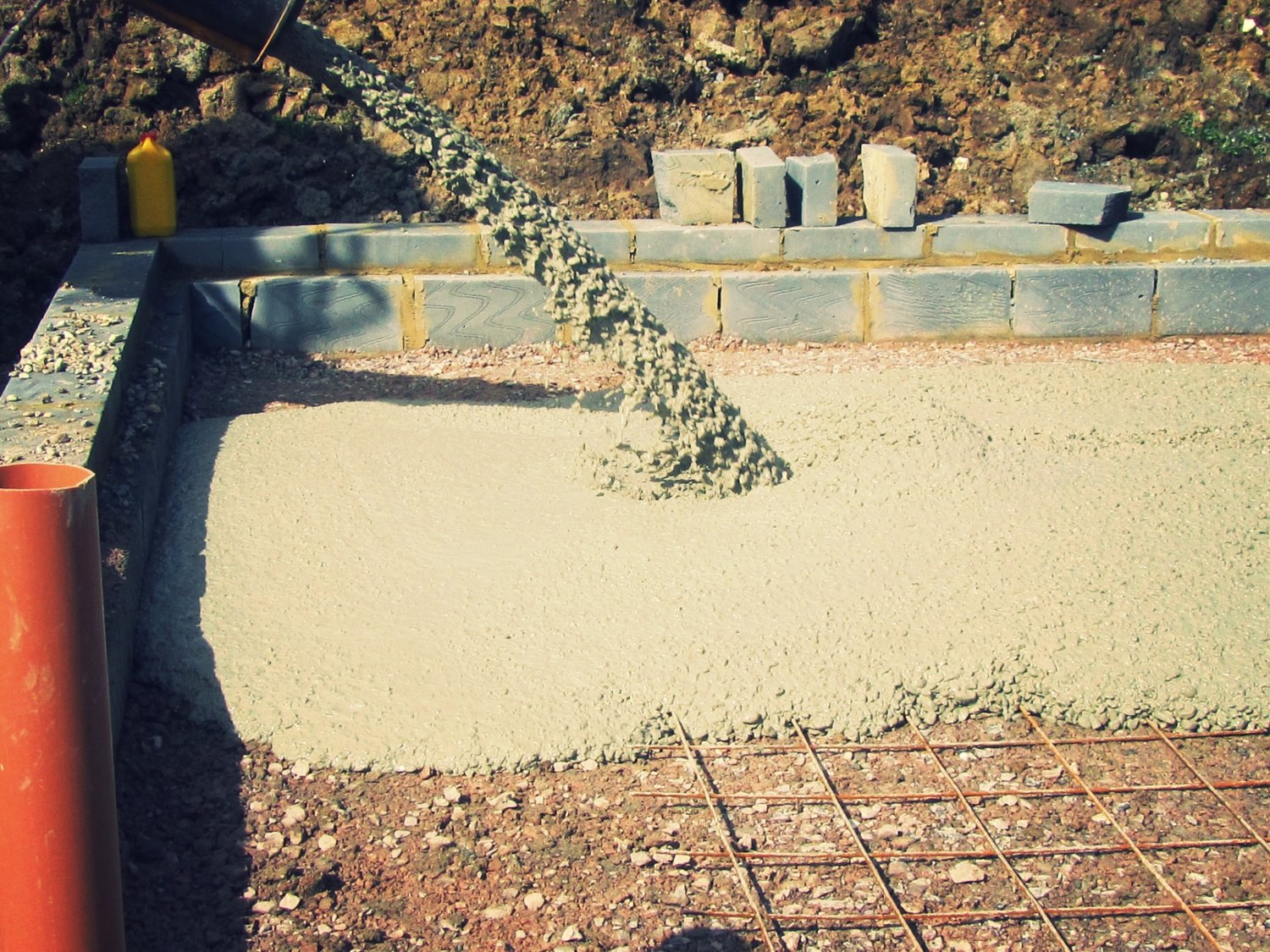 Filling in the foundation with concrete for an eco home in West Sussex