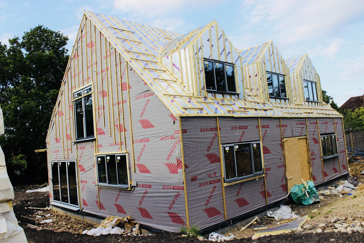 Adding the insulation panels, and windows to an eco home in West Sussex
