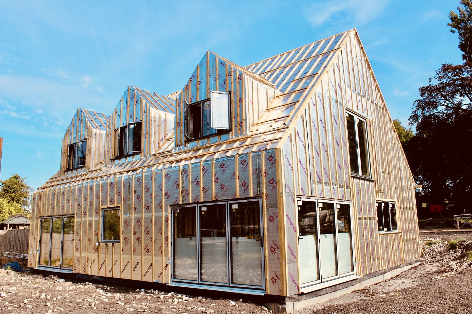 Insulation panels fulled added to the outer frame of an eco home in West Sussex