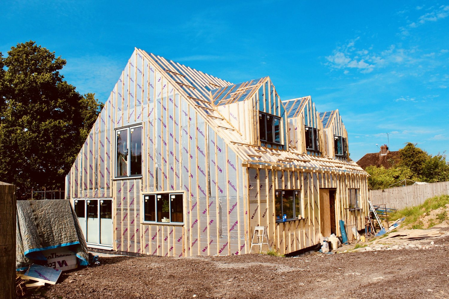 Side view of the insulation panels being fully installed on a eco home in West Sussex