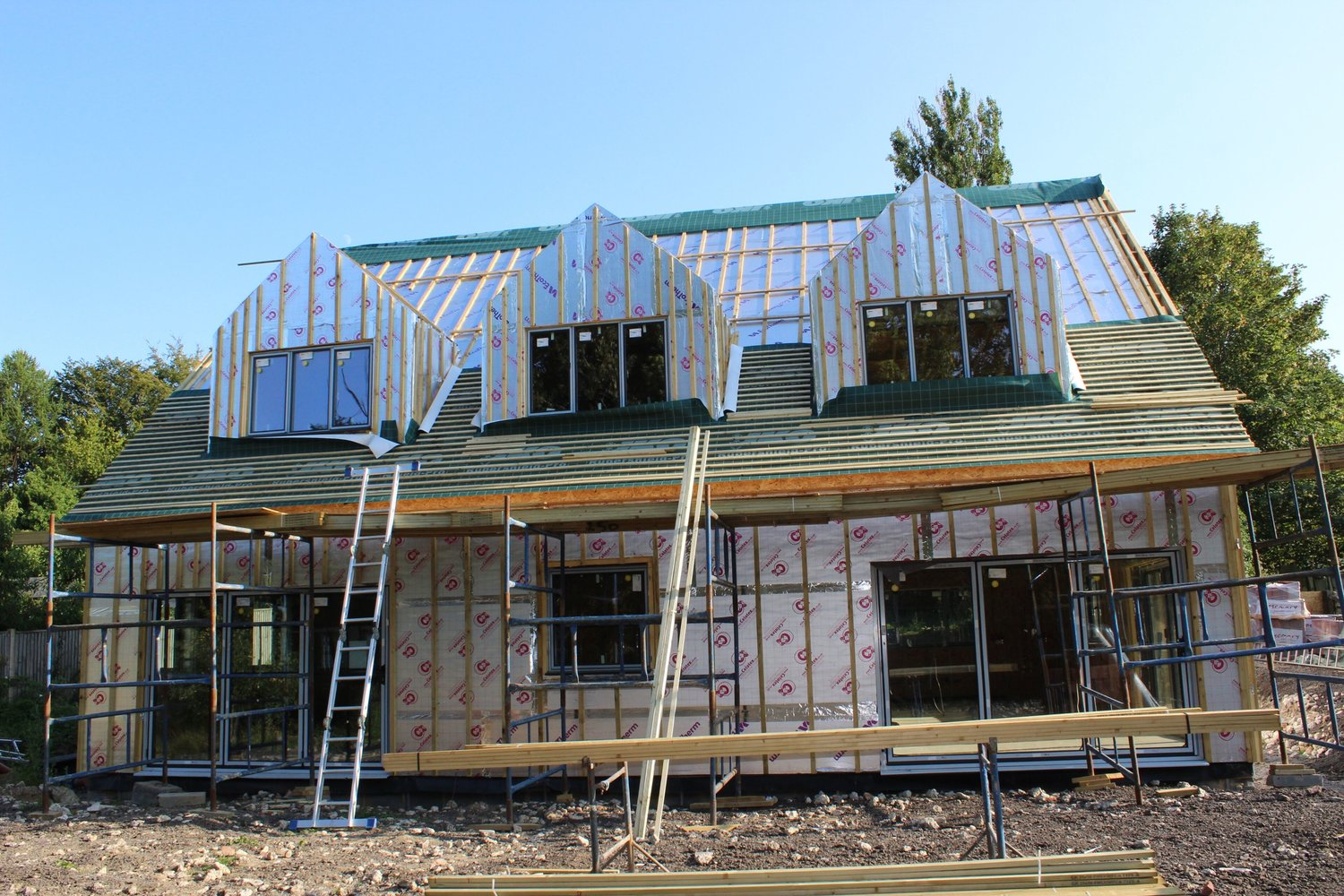 The external insulation panels from the rear elevation of a eco home in West Sussex