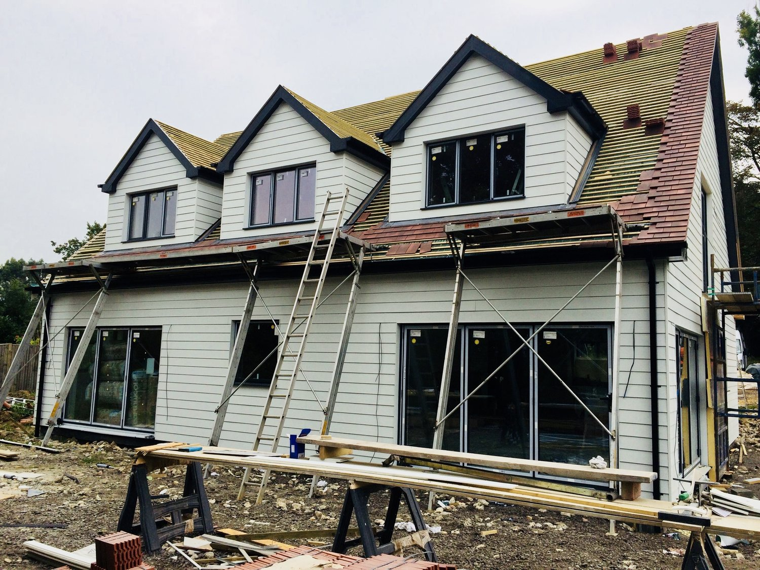 The weather boards being installed to the exterior of a eco home In West Sussex