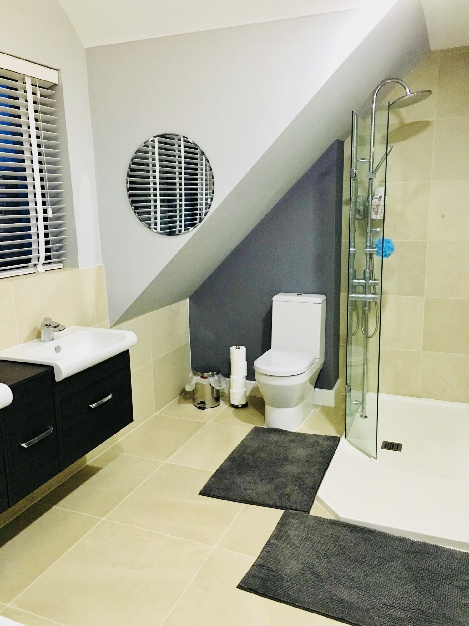 Floating sink, toilet, and walk in shower for a sophisticated modern look for a eco home in West Sussex