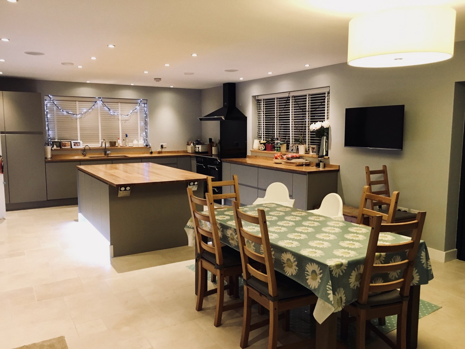 The completed kitchen with wooden worktops and a sleek cabinet design for a minimalist modern look, and lounge area for a eco home in West Sussex
