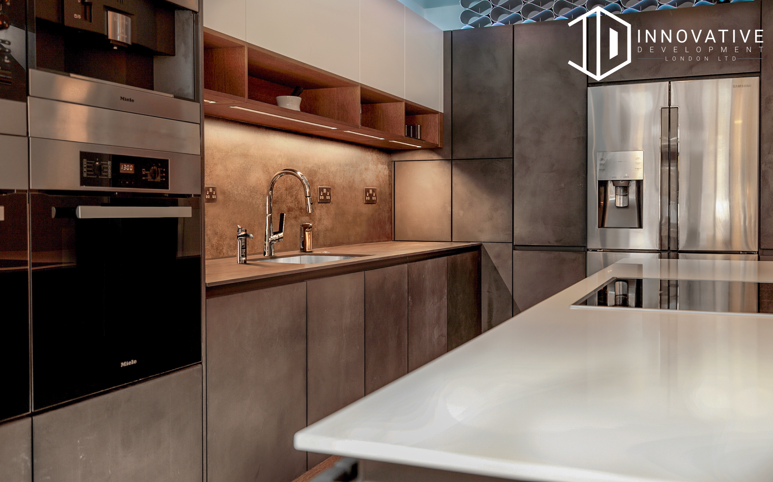 The cooking area of a stunning modern kitchen with a creamy interior design for a completed Kitchen extension in Chiswick