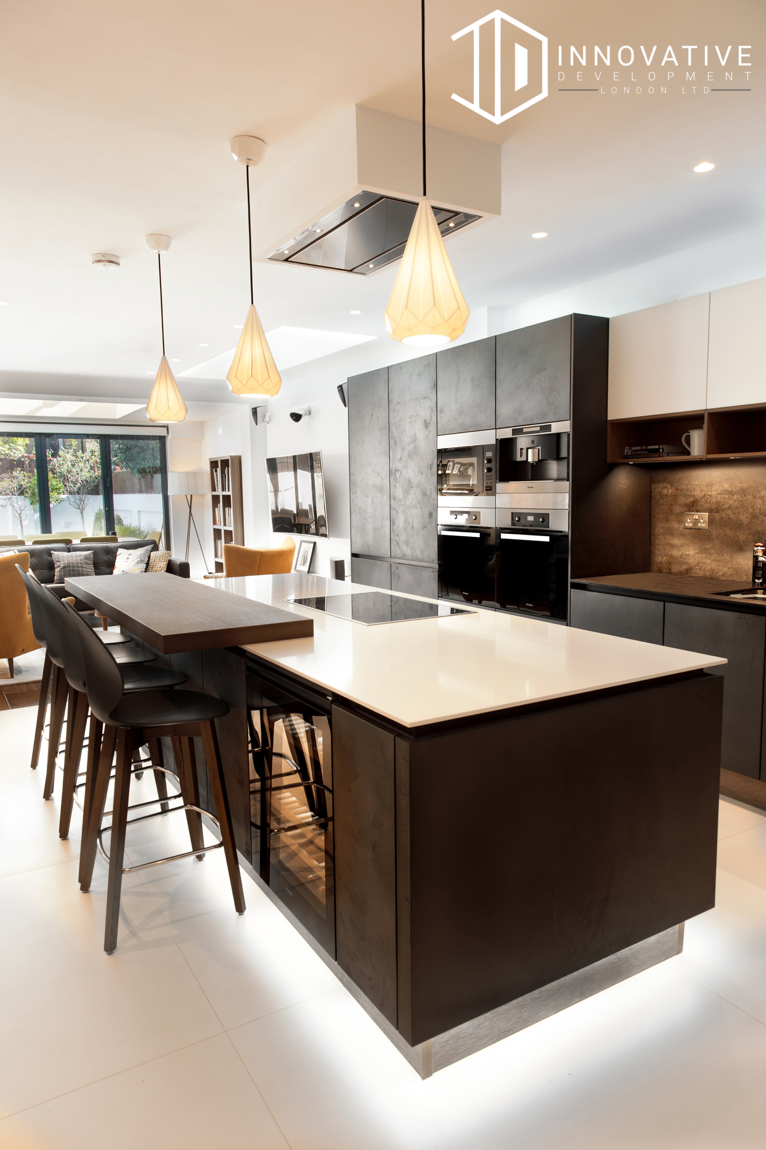 Large modern spacious Kitchen, and Living room area with creamy Interior design for a completed Kitchen Extension in Chiswick