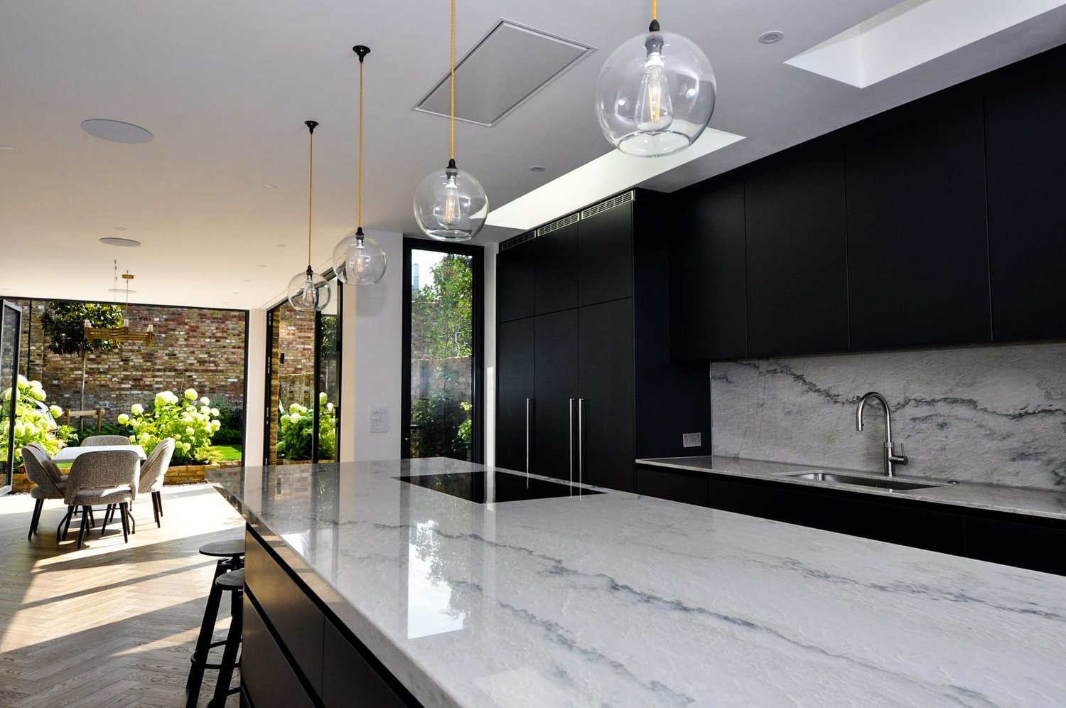 Beautiful Kitchen marble worktops and a modern interior design for a completed Kitchen Extension in West Hampstead