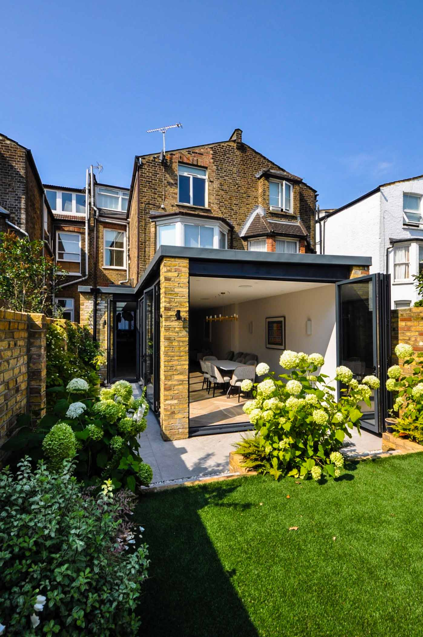 Exterior garden view for a completed kitchen extension with a modern spacious interior in West Hampstead