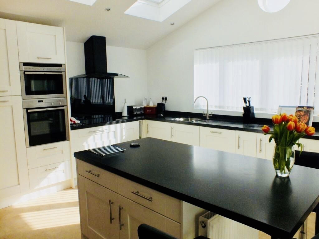 Island worktop of a stunning naturally lit Kitchen extension completed in Surbiton