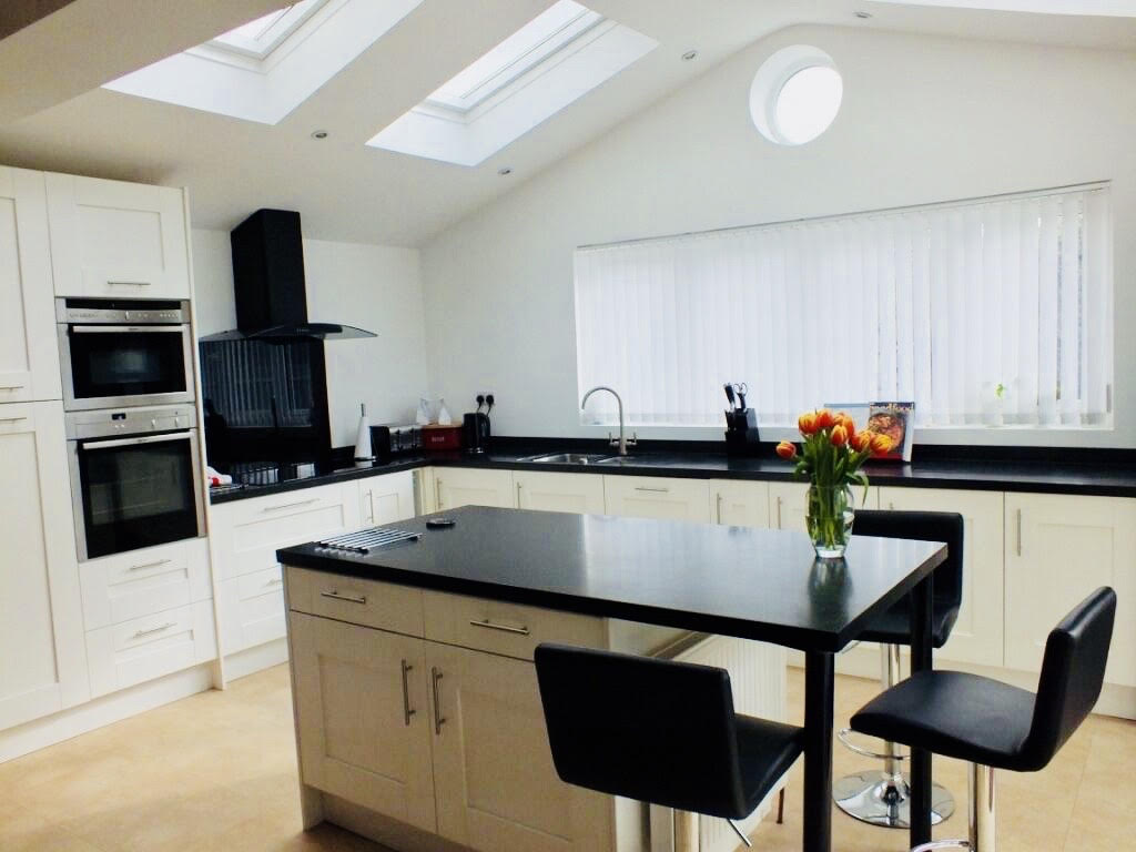 Island dining area to save space, for a stunning naturally lit completed Kitchen extension in Subiton