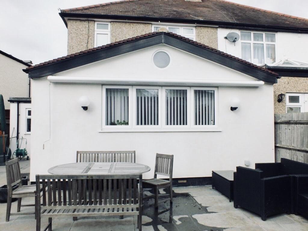 Exterior garden view of a stunning naturally lit Kitchen extension in Surbiton